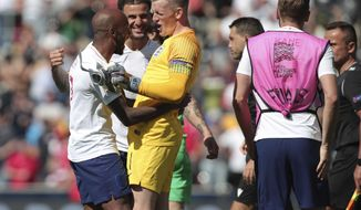 England's Fabian Delph, England's Kyle Walker, England goalkeeper Jordan Pickford celebrate after the winning at the end the UEFA Nations League third place soccer match between Switzerland and England at the D. Afonso Henriques stadium in Guimaraes, Portugal, Sunday, June 9, 2019. (AP Photo/Luis Vieira)