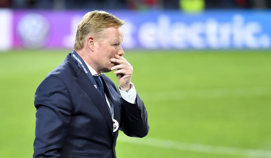 Netherlands coach Ronald Koeman walks in dejection after receiving his second place medal after the UEFA Nations League final soccer match between Portugal and Netherlands at the Dragao stadium in Porto, Portugal, Sunday, June 9, 2019. Portugal won 1-0. (AP Photo/Martin Meissner)