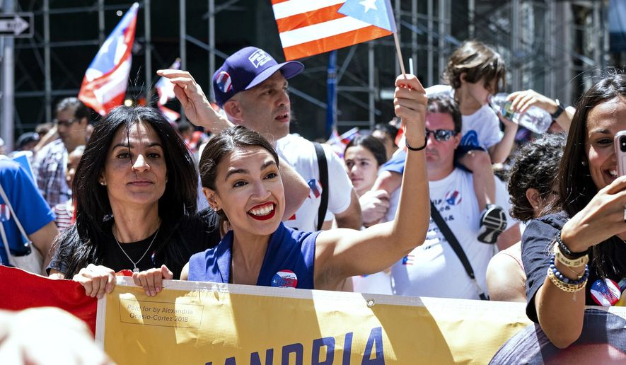 Rep. Alexandria Ocasio-Cortez, D-N.Y., center, takes part in the National Puerto Rican Day Parade, Sunday, June 9, 2019, in New York. (AP Photo/Craig Ruttle)