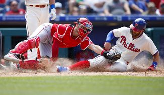 Philadelphia Phillies' Bryce Harper, right, is tagged out by Cincinnati Reds catcher Curt Casali after trying to steal home during the fifth inning of a baseball game, Sunday, June 9, 2019, in Philadelphia. (AP Photo/Matt Slocum)