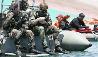 U.S. Navy and Philippine Coast Guard divers conduct search-and-rescue operation for the sunken passenger ferry, MV Princess of the Stars, off Sibuyan Island in central Philippines on Wednesday, June 25, 2008. (AP Photo/Bullit Marquez) ** FILE **
