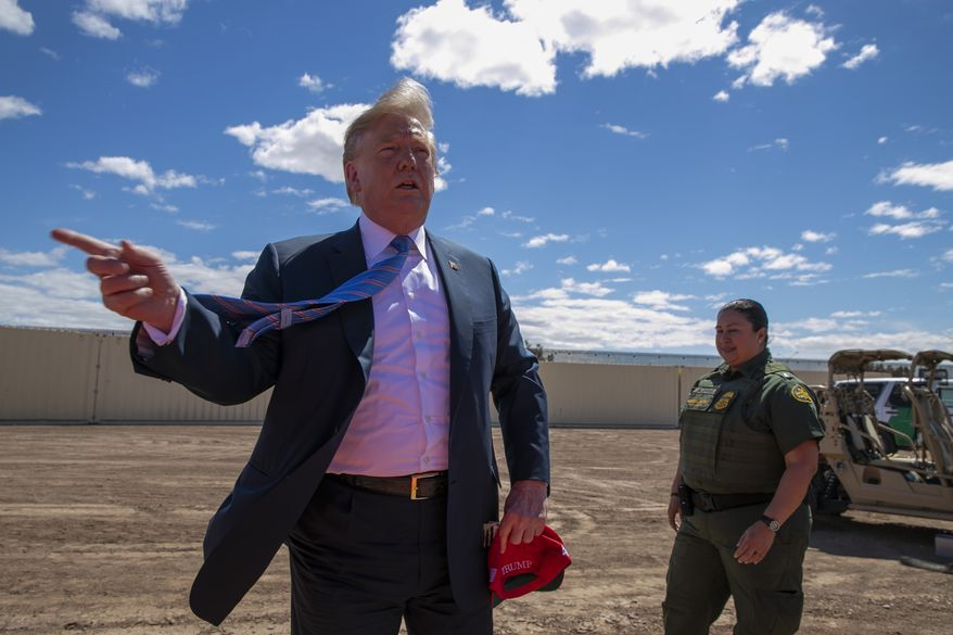 In this Friday, April 5, 2019, file photo, President Donald Trump speaks as he visits a new section of the border wall with Mexico in Calexico, Calif. (AP Photo/Jacquelyn Martin, File)