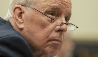 Former White House counsel John Dean looks around the hearing room upon arrival for a House Judiciary Committee hearing on the Mueller Report, Monday, June 10, 2019. (AP Photo/Manuel Balce Ceneta)