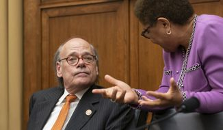 House Judiciary Committee members Rep. Steve Cohen, D-Tenn., left, listens to Rep. Karen Bass, D-Calif., as House Democrats start a hearing to examine whether President Donald Trump obstructed justice, the first of several hearings scheduled by Democrats on special counsel Robert Mueller's report, on Capitol Hill in Washington, Monday, June 10, 2019.  (AP Photo/J. Scott Applewhite)