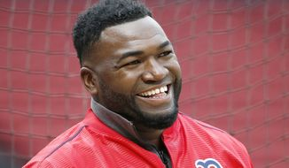 FILE - In this April 12, 2016, file photo, Boston Red Sox's David Ortiz smiles during batting practice before a baseball game against the Baltimore Orioles, in Boston. Former Boston Red Sox slugger David Ortiz was hospitalized Monday following surgery for a gunshot wound after being ambushed by a man in a bar in his native Dominican Republic, authorities said. Dominican National Police Director Ney Aldrin Bautista Almonte said Ortiz was at the Dial Bar and Lounge in Santo Domingo around 8:50 p.m. Sunday, June 9, 2019, when a gunman approached from behind and shot him at close range. Ortiz was taken to the Abel Gonzalez clinic, where he underwent surgery, and his condition was stable, Bautista said. (AP Photo/Michael Dwyer) ** FILE **