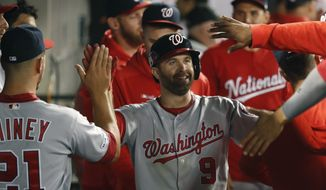 Washington Nationals' Brian Dozier (9) celebrates in the dugout after scoring during the eighth inning of a baseball game against the Chicago White Sox, Monday, June 10, 2019, in Chicago. (AP Photo/Charles Rex Arbogast) ** FILE **
