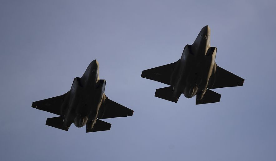 In this Nov. 1, 2018, file photo U.S. Air Force F-35 A-fighter jets from 31st Test Evaluation Squadron at Edwards AFB fly over Levi's Stadium before an NFL football game between the San Francisco 49ers and the Oakland Raiders in Santa Clara, Calif. Raytheon Co. and United Technologies Corp. are merging in a deal that creates one of the world's largest defense companies. The merger was announced Sunday, June 9, 2019. United Technologies makes engines for Lockheed Marti Corp.'s F-35 stealth fighter. (AP Photo/Ben Margot, File)