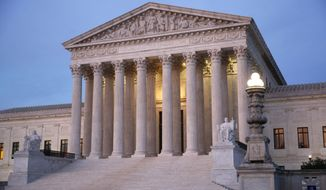 In this May 23, 2019, photo, the U.S. Supreme Court building at dusk on Capitol Hill in Washington. The Supreme Court is rejecting a challenge to federal regulation of gun silencers, just days after a gunman used one in a shooting rampage that killed 12 people in Virginia. The justices did not comment Monday, June 10, in turning away appeals from two Kansas men who were convicted of violating federal law regulating silencers (AP Photo/Patrick Semansky)