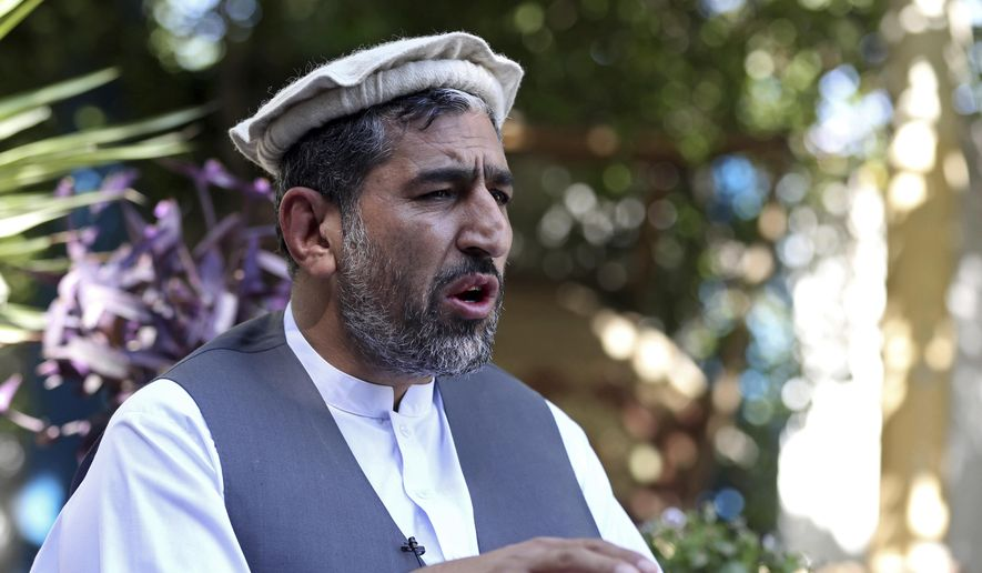 In this Thursday, May 30, 2019, file photo, Ajmal Omar a member of the Nangarhar provincial council speaks during an interview with The Associated Press in the city of Jalalabad, Afghanistan. (AP Photo/Rahmat Gul)