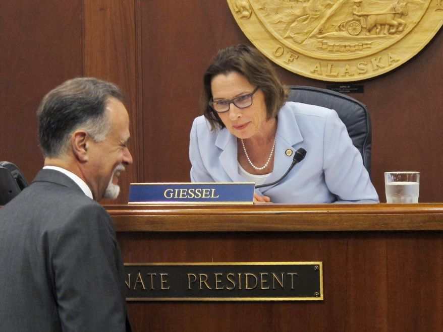 Alaska Senate President Cathy Giessel speaks with Sen. Peter Micciche before the start of the Senate floor session on Monday, June 10, 2019, in Juneau, Alaska. The Senate approved a compromise state operating budget but failed to revive a bill that would pay residents a full dividend this year from the state's oil-wealth fund. (AP Photo/Becky Bohrer)