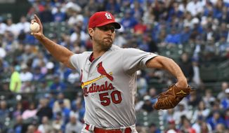 St. Louis Cardinals starting pitcher Adam Wainwright delivers during the first inning of a baseball game against the Chicago Cubs, Sunday, June 9, 2019, in Chicago. (AP Photo/Matt Marton)