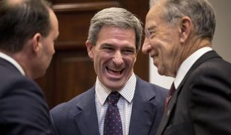 FILE - In this Nov. 14, 2018, file photo, from left, Sen. Mike Lee, R-Utah, former Virginia Attorney General Ken Cuccinelli, and Sen. Chuck Grassley, R-Iowa, laugh before President Donald Trump arrived to announce his support for the first major rewrite of the nation's criminal justice sentencing laws at White House in Washington. Cuccinelli has been named acting director of U.S. Citizenship and Immigration Services. (AP Photo/Andrew Harnik, File)