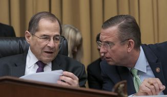 House Judiciary Committee Chairman, Rep. Jerrold Nadler, D-N.Y., left, talks with Rep. Doug Collins, R-Georgia, the ranking member, as House Democrats start a hearing to examine whether President Donald Trump obstructed justice, the first of several hearings scheduled by Democrats on special counsel Robert Mueller's report, on Capitol Hill in Washington, Monday, June 10, 2019. (AP Photo/J. Scott Applewhite)