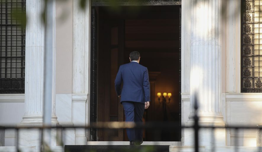 CORRECTING NAME OF PRESIDENT TO PROKOPIS PAVLOPOULOS - Greek Prime Minister Alexis Tsipras, enters his office after his meeting with Greek President Prokopis Pavlopoulos, in Athens, on Monday, June 10, 2019. Tsipras visited Greece's president to formally call for the dissolution of parliament and early elections on July 7, following his party's heavy defeat in European elections last month.(AP Photo/Petros Giannakouris)