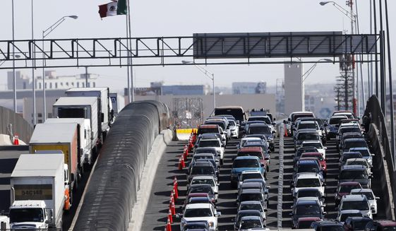 """FILE - In this March 29, 2019, file photo, vehicles line up to enter the U.S. from Mexico at a border crossing in El Paso, Texas. Customs and Border Protection said Monday, June 10, that photos of travelers and license plates collected at a single U.S. border point have been exposed in a malicious cyberattack in what a leading congressman called a """"major privacy breach."""" (AP Photo/Gerald Herbert, File)"""