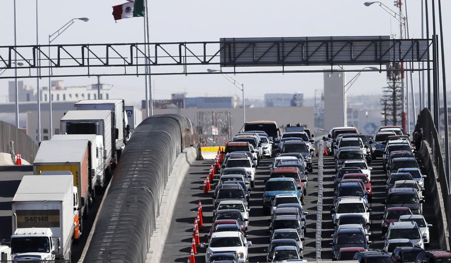 "FILE - In this March 29, 2019, file photo, vehicles line up to enter the U.S. from Mexico at a border crossing in El Paso, Texas. Customs and Border Protection said Monday, June 10, that photos of travelers and license plates collected at a single U.S. border point have been exposed in a malicious cyberattack in what a leading congressman called a ""major privacy breach."" (AP Photo/Gerald Herbert, File)"