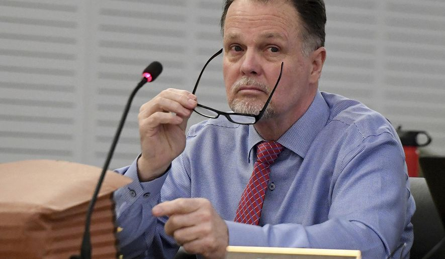 "FILE - In this Jan. 7, 2019, file photo, murder defendant Charles Ray Merritt sits in San Bernardino County Court prior to opening statements in San Bernardino, Calif. A jury verdict will be read in the case of a Southern California man charged with killing a family of four and burying their bodies in the desert. The verdict will be read Monday, June 10, 2019, in court in San Bernardino in the quadruple murder case against 62-year-old Charles ""Chase"" Merritt. (Will Lester/The Orange County Register via AP, Pool, File)"