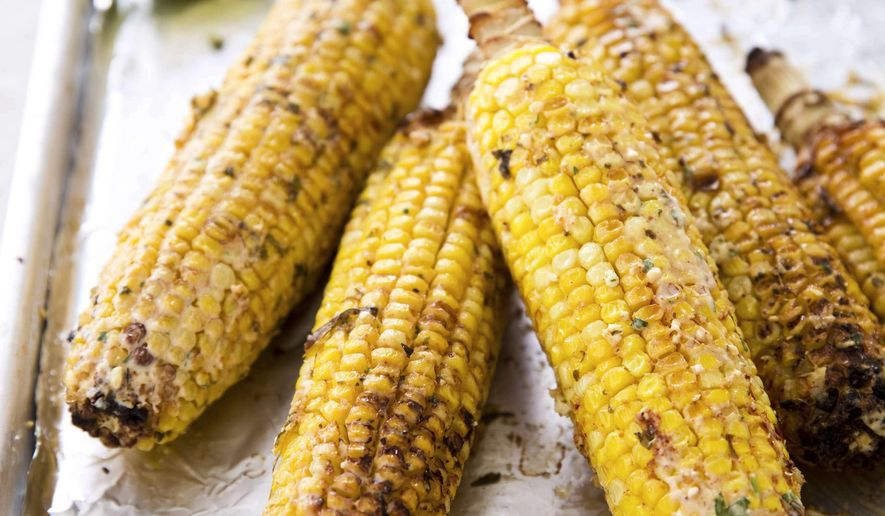 "This undated photo provided by America's Test Kitchen in June 2019 shows Mexican Street Corn.  This recipe appears in the cookbook ""The New Essentials Cookbook."" (Joe Keller/America's Test Kitchen via AP)"
