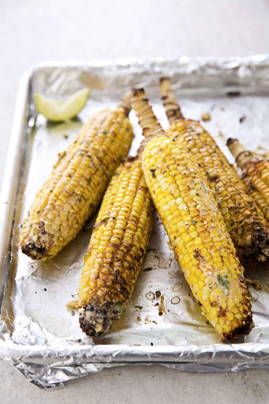 """This undated photo provided by America's Test Kitchen in June 2019 shows Mexican Street Corn.  This recipe appears in the cookbook """"The New Essentials Cookbook."""" (Joe Keller/America's Test Kitchen via AP)"""