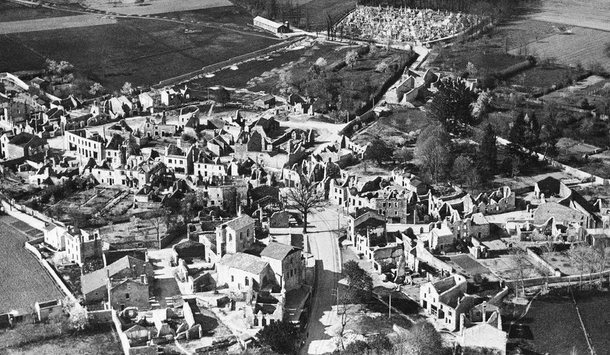 FILE - This Jan. 1, 1953 aerial file picture showing the destroyed village of Oradour-sur-Glane, central France, that is today a phantom village, with burned-out cars and abandoned buildings left as testimony to its history.  France remembered on Monday June 10, 2019, the 642 people killed in the small village of Oradour-sur-Glane 75-years ago, in what was the biggest massacre of civilians by Nazi troops during their occupation of the country in World War II. (AP Photo, File)