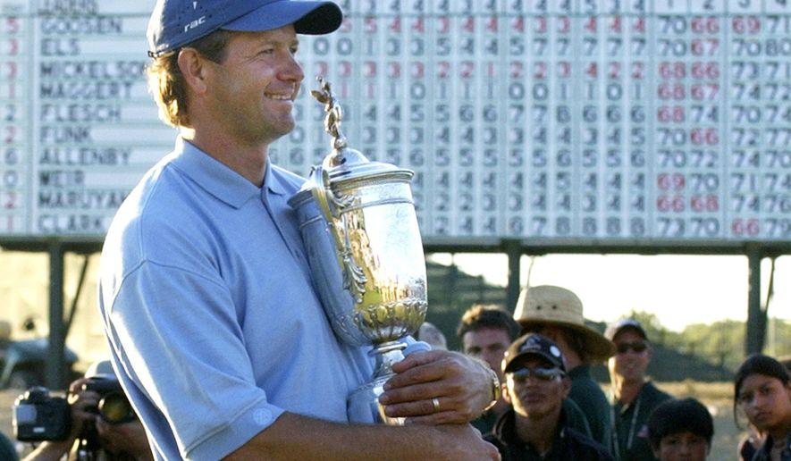 FILE - In this June 20, 2004, file photo, Retief Goosen, of South Africa, holds the U.S. Open Championship trophy at Shinnecock Hills Golf Club in Southampton, N.Y. Goosen was inducted into the World Golf Hall of Fame, Monday, June 10, 2019. (AP Photo/Charles Krupa, File)