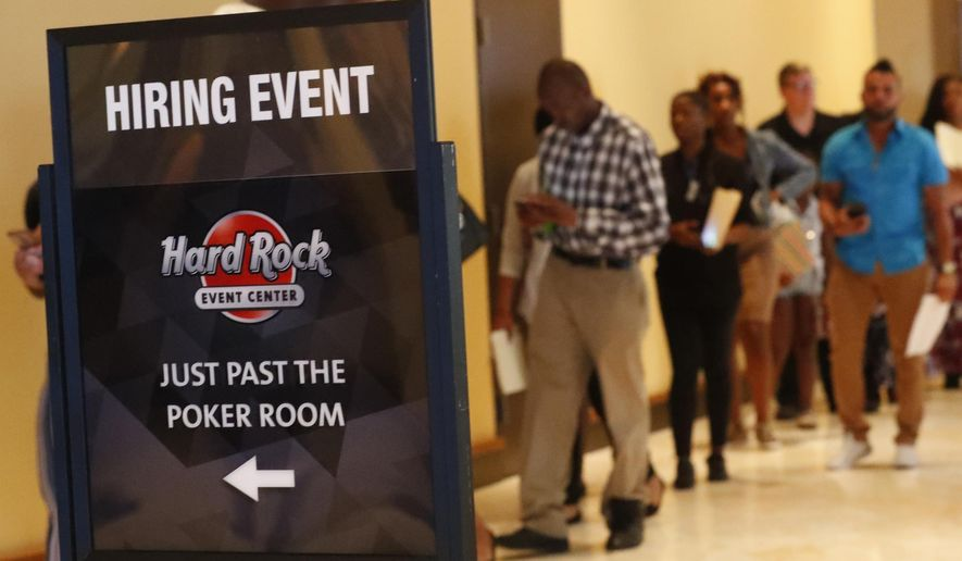 In this Tuesday, June 4, 2019 photo,  job applicants line up at the Seminole Hard Rock Hotel & Casino Hollywood during a job fair in Hollywood, Fla. On Monday, June 10, the Labor Department reports on job openings and labor turnover for April. (AP Photo/Wilfredo Lee)