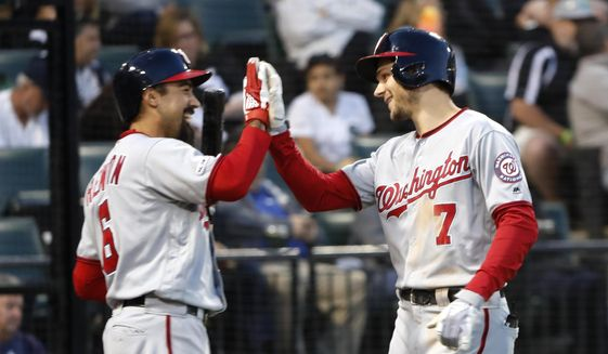 Washington Nationals' Trea Turner (7) celebrate his home run with Anthony Rendon during the fifth inning of a baseball game against the Chicago White Sox, Monday, June 10, 2019, in Chicago. (AP Photo/Charles Rex Arbogast) ** FILE **