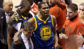 Golden State Warriors forward Kevin Durant (35) reacts as he leaves the court after sustaining an injury during first-half basketball action against the Toronto Raptors in Game 5 of the NBA Finals in Toronto, Monday, June 10, 2019. (Chris Young/The Canadian Press via AP) ** FILE **