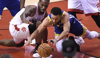Toronto Raptors forward Kawhi Leonard (2) and Golden State Warriors guard Stephen Curry (30) vie for the ball during first-half basketball action in Game 5 of the NBA Finals in Toronto, Monday, June 10, 2019. (Frank Gunn/The Canadian Press via AP)