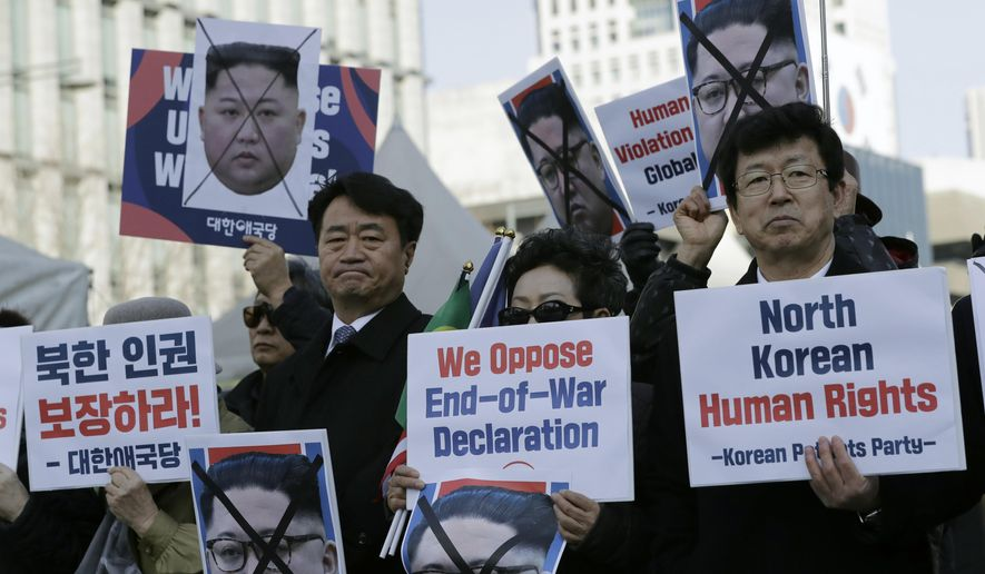 FILE - In this Feb. 26, 2019, file photo, South Korean protesters and North Korean defectors hold portraits of North Korean leader Kim Jong Un during a rally urging the United States to discuss North Korean human rights issues in the upcoming summit between U.S. President Donald Trump and North Korean leader Kim Jong Un near the U.S. embassy in Seoul, South Korea. The Seoul-based human rights group Transitional Justice Working Group said Tuesday, June 11, 2019, it has carried out research to identify hundreds of sites where witnesses claim North Korea has carried out public executions as it continues to aggressively use the death penalty to intimidate its citizens. (AP Photo/Lee Jin-man, File)