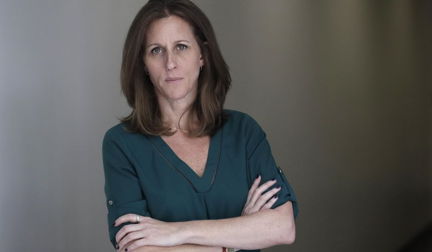 """Kim Goldman poses for a portrait Friday, June 7, 2019, in Los Angeles. Goldman has continued to make the case publicly that it was O.J. Simpson who killed her brother and Simpson's ex-wife on a June night in 1994. Beginning Wednesday, Goldman will examine the case in a 10-episode podcast, """"Confronting: OJ Simpson."""" She'll interview her brother's old friends, the police detective who investigated the killings, attorneys for the defense and prosecution, and two of the 12 jurors who voted to acquit Simpson. (AP Photo/Marcio Jose Sanchez)"""