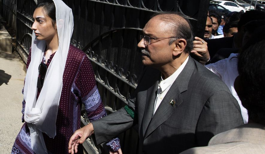 Former Pakistani president and leader of Pakistan People's party, Asif Ali Zardari, center, leaves the High Court building with his daughter Asifa Bhutto Zardari, in Islamabad, Pakistan, Monday, June 10, 2019. A Pakistani court has rejected a request by Zardari and his sister for an extension of their bail that would allow them to remain free despite facing a multimillion-dollar money laundering case. (AP Photo/B.K. Bangash)
