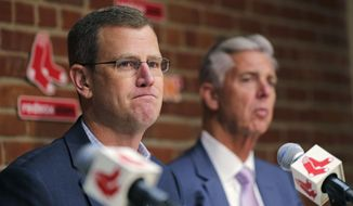 Boston Red Sox president Sam Kennedy, left, addresses the media during a news conference updating the status of former Red Sox designated hitter David Ortiz at Fenway Park in Boston, Monday, June 10, 2019. Ortiz was shot at a bar Sunday night in his native Dominican Republic. President of baseball operations Dave Dombrowski, right, looks on. (AP Photo/Charles Krupa)