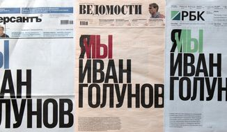 """In this photo, Russia's three major newspapers use the same headline that reads: """"I'm/we are Ivan Golunov"""", which is the name of a prominent Russian investigative reporter, who worked for the independent website Meduza, in Moscow, Russia, Monday, June 10, 2019. In a show of rare solidarity, Kommersant, Vedomosti and RBK, among the most respected daily newspapers in the country, published a joint editorial under the headline """"I am/We are Ivan Golunov,"""" calling for a transparent probe into the case of the prominent investigative journalist. (AP Photo/Alexander Zemlianichenko)"""