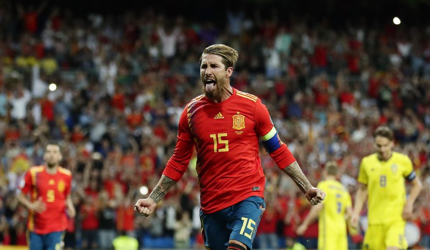 Spain's Sergio Ramos celebrates after scoring the opening goal with a penalty during the Euro 2020 Group F qualifying soccer match between Spain and Sweden at the Santiago Bernabeu stadium in Madrid, Monday June 10, 2019. (AP Photo/Manu Fernandez)