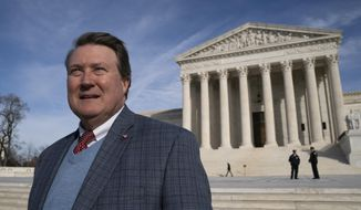 FILE - In this Feb. 14, 2019, file photo, Mitch Hungerpiller of Birmingham, Ala., who invented a computerized system to automate the processing of returned mail, poses for a photo outside of the Supreme Court in Washington. The Supreme Court is siding with an Alabama company over the U.S. Postal Service in a patent dispute. The justices said Monday, June 10, that the government can't use a 2011 law to challenge a patent held by Birmingham-based Return Mail. The dispute involves a patent Return Mail got for a system that processes mail that gets returned as undeliverable. (AP Photo/J. Scott Applewhite, File)
