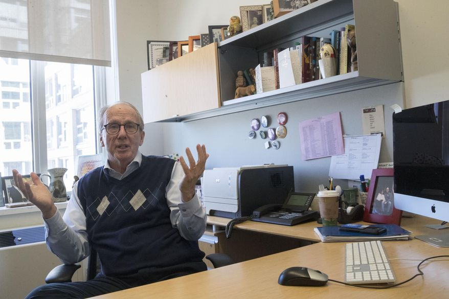 In this Tuesday, April 16, 2019, photo Steve Burghardt, a professor of social work at the City University of New York, gestures as he speaks in his office at Hunter College's Silberman School of Social Work. Seniors in major metropolitan areas, especially in big Northeastern cities and around Washington, D.C., are more likely to continue working past 65 than those in other areas around the country, according to an analysis of Census cata by The Associated Press and the NORC Center for Public Affairs Research (AP Photo/Mary Altaffer)