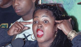 Rap artist Sister Souljah speaks at a conference in New York City on June 16, 1992. Souljah made claims that U.S. Presidential candidate Bill Clinton wasn't in touch with the problems of Black-America. Hip-hop star Doug E. Fresh is in the background. (AP Photo/Alex Brandon)