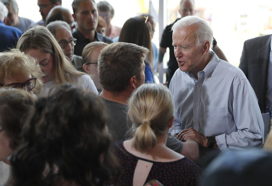 Democratic presidential candidate former Vice President Joe Biden greets supporters after a town hall meeting, Tuesday, June 11, 2019, in Ottumwa, Iowa. (AP Photo/Matthew Putney) ** FILE **