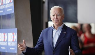 Democratic presidential candidate former Vice President Joe Biden greets the crowd at a town hall meeting, Tuesday, June 11, 2019, in Ottumwa, Iowa. (AP Photo/Matthew Putney)