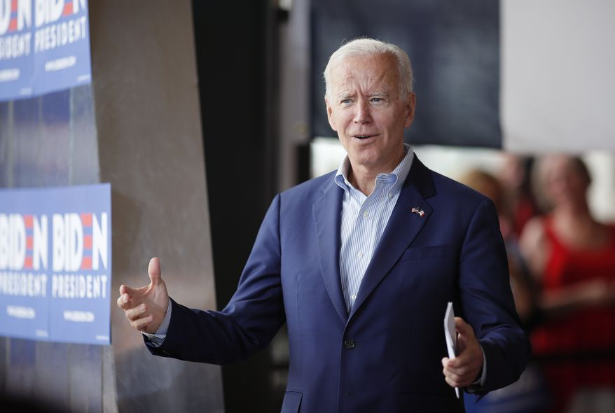 Democratic presidential candidate former Vice President Joe Biden greets the crowd at a town hall meeting, Tuesday, June 11, 2019, in Ottumwa, Iowa. (AP Photo/Matthew Putney) ** FILE **