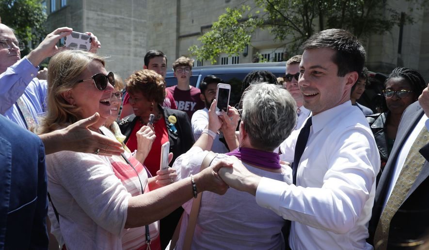 Democratic presidential candidate Mayor Pete Buttigieg greets supporters after delivering remarks on foreign policy and national security during a speech at the Indiana University Auditorium in Bloomington, Ind., Tuesday, June 11, 2019. (AP Photo/Michael Conroy)