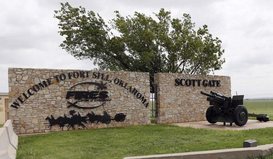 This June 17, 2014, photo shows an entrance to Fort Sill near Lawton, Okla. The federal government has chosen the military base in Oklahoma as the location for a new temporary shelter to house migrant children and is considering a customs port in southern New Mexico as another option as existing shelters are overwhelmed. The Office of Refugee Resettlement said Tuesday, June 11, 2019 it's dealing with a dramatic spike in the number of children crossing the border without parents. (AP Photo/Sue Ogrocki) **FILE**
