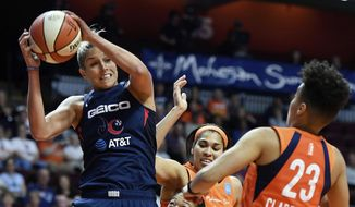 Washington Mystics forward Elena Delle Donne pulls down a rebound next to Connecticut Sun guard Layshia Clarendon during a WNBA basketball game Tuesday, June 11, 2019, in Uncasville, Conn. (Sean D. Elliot/The Day via AP) **FILE**