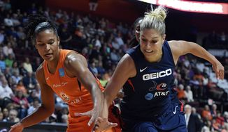 Connecticut Sun forward Alyssa Thomas, left, battles Washington Mystics forward Elena Delle Donne for a loose ball during the second half of a WNBA basketball game Tuesday, June 11, 2019, in Uncasville, Conn. (Sean D. Elliot/The Day via AP) **FILE**