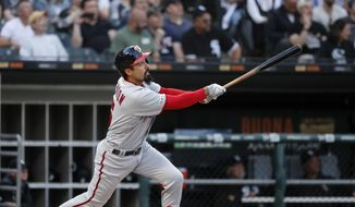 Washington Nationals' Anthony Rendon watches his two-run home run off Chicago White Sox starting pitcher Manny Banuelos during the first inning of a baseball game Tuesday, June 11, 2019, in Chicago. (AP Photo/Charles Rex Arbogast) ** FILE **