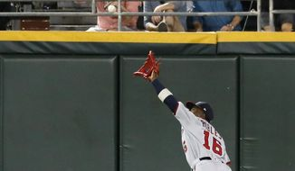 Washington Nationals center fielder Victor Robles catches a deep fly ball from Chicago White Sox's Leury Garcia during the fifth inning of a baseball game Tuesday, June 11, 2019, in Chicago. (AP Photo/Charles Rex Arbogast) **FILE**
