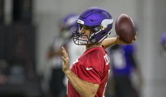 Minnesota Vikings quarterback Kirk Cousins throws during drills at the team's NFL football training facility in Eagan, Minn. Tuesday, June 11, 2019. (AP Photo/Andy Clayton-King) ** FILE **