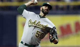 Oakland Athletics' Mike Fiers pitches to the Tampa Bay Rays during the first inning of a baseball game Tuesday, June 11, 2019, in St. Petersburg, Fla. (AP Photo/Chris O'Meara)