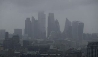 The skyline is seen through the rain and mist in London, Monday June 10, 2019. (AP Photo/Matt Dunham)